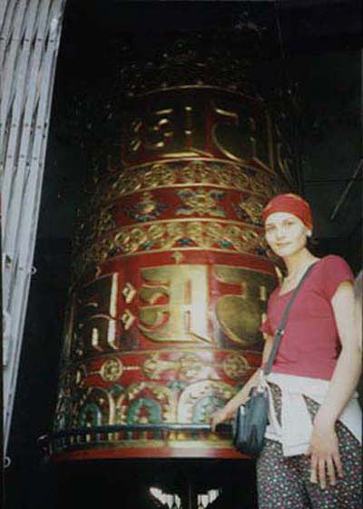 SPINNING THE GIANT PRAYER WHEEL AT BOUDHANATH STUPA
