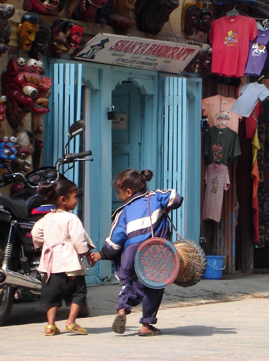 KID STROLL BY TIBETAN MASK SHOP KATHMANDU