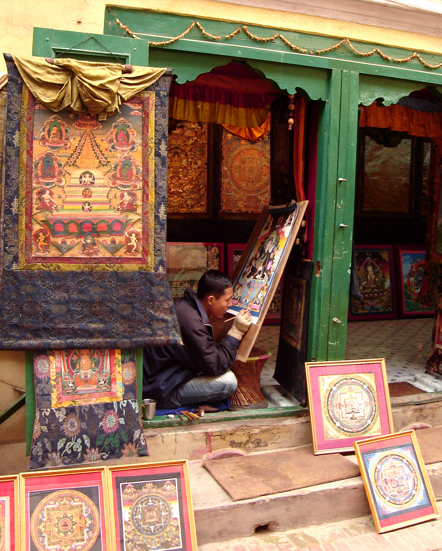 TIBETAN THANGKAS BEING PAINTED