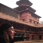 PAGODA TEMPLE RISES FROM CENTER OF ANCIENT NEPAL BUILDING