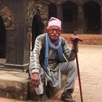 OLD PILGRIM IN BUDDHIST TEMPLE BHAKTAPUR NEPAL