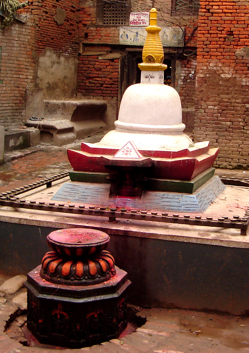 RED TIKA POWDER ADORNS THIS SMALL KATHMANDU NEIGHBORHOOD STUPA